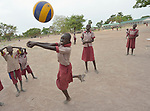 Students play volleyball in the Loreto Primary School in Rumbek, South Sudan. The Loreto Sisters began a secondary school for girls in 2008, with students from throughout the country, but soon after added a primary in response to local community demands.