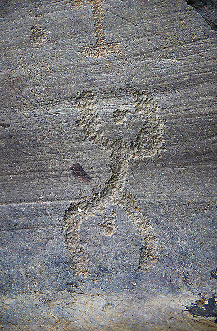 """Prehistoric petroglyph rock carvings of """"A procession of Praying Figures"""" carved by the Camunni people in the iron age between 1000-1600 BC, from Rock 32 of  National Park of Naquane, Lombardy, Italy"""