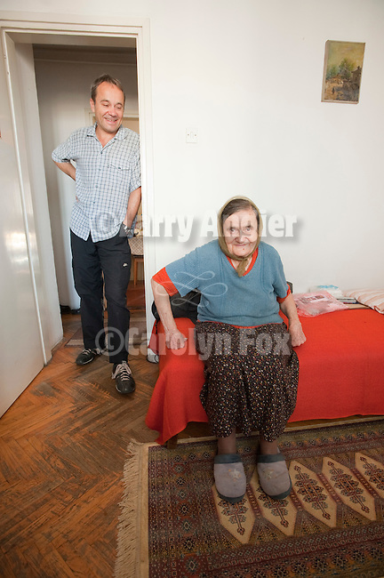 Miloje Milinkovic with his mother, Milojka, age 81, on his 51st birthday at apartment of her brother at the top of a building in downtown Belgrade, Serbia