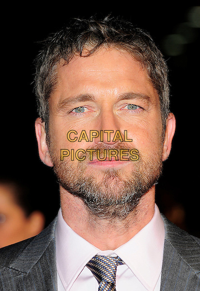 GERARD BUTLER .Attending 'The Bounty Hunter' UK film premiere at the Vue West End,cinema Leicester Square, London, England, UK, 11th March 2010 .arrivals portrait headshot beard facial hair stubble tie white shirt mouth open  grey gray .CAP/BEL.©Tom Belcher/Capital Pictures