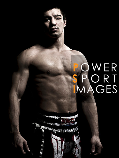 """Muay Thai Kickboxing figther Ramazan Ramazanov of Russia poses at a gymnasium in Bangkok, Thailand. Muay Thai, also know as """"Art of Eight Limbs"""", is a hard martial art and Thailand's national sport. Photo by Victor Fraile --- Image by © Victor Fraile"""