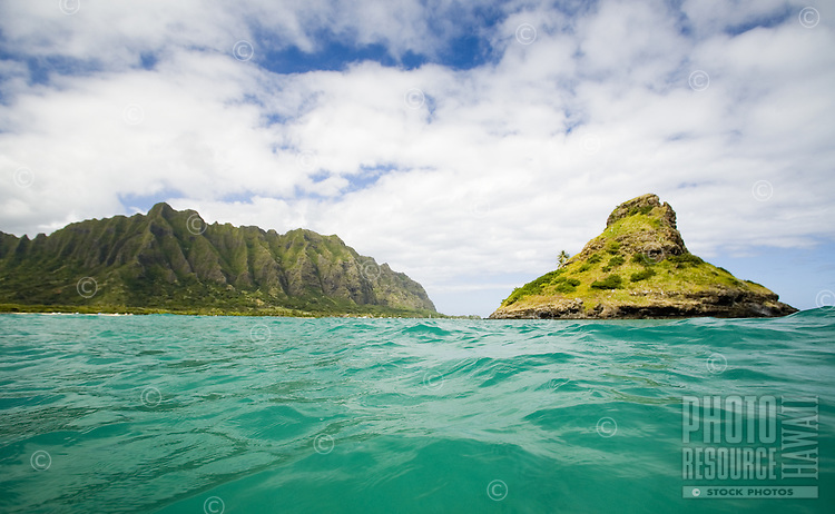 Chinaman's Hat and crenelated mountains of Kualoa from offshore in Kaneohe Bay