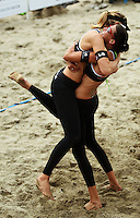New Zealand's Susan Blundell and Anna Scarlet celebrate winning the women's final during the 2009 McEntee Hire NZ Beach Volleyball Tour - Women's final at Oriental Parade, Wellington, New Zealand on Sunday, 11 January 2009. Photo: Dave Lintott / lintottphoto.co.nz.