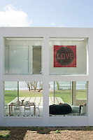 The heart of the house is a see-through space, with glazing front and back, allowing the eye to pass through the building to the beach and the sea