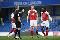 Referee Mr Will Finnie puts his hand up in front of Arsenal's Danny Ballard during Chelsea Under-23 vs Arsenal Under-23, Premier League 2 Football at Stamford Bridge on 15th April 2019