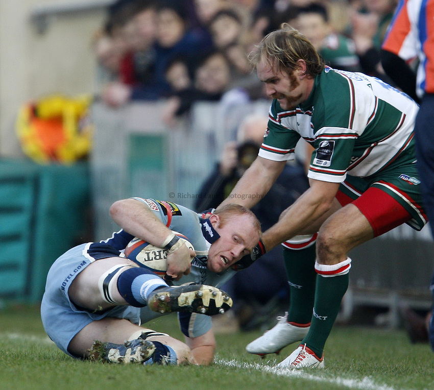 Photo: Richard Lane/Richard Lane Photography..Leicester Tigers v Cardiff Blues. EDF Energy Cup. 03/11/2007. .Blues' Martyn Williams is pulled into touch by Tigers' Andy Goode.