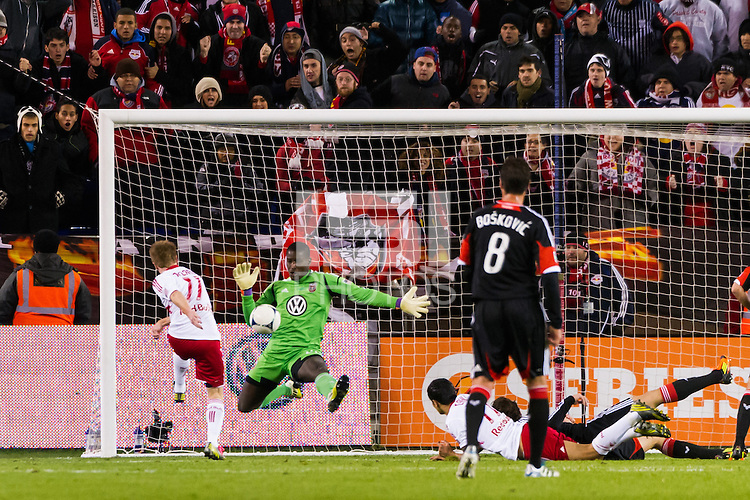 D. C. United goalkeeper Bill Hamid (28) makes a save on Dax McCarty (11) of the New York Red Bulls. D. C. United defeated the New York Red Bulls 1-0 (2-1 in aggregate) during the second leg of the MLS Eastern Conference Semifinals at Red Bull Arena in Harrison, NJ, on November 8, 2012.