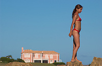 Micaela (cq) Molina, 21, peers out to sea near a stylish home on a beach in La Barra near Punta del Este, Uruguay. The venerable South American beach resort is having a rennaisance. (Kevin Moloney for the New York Times)