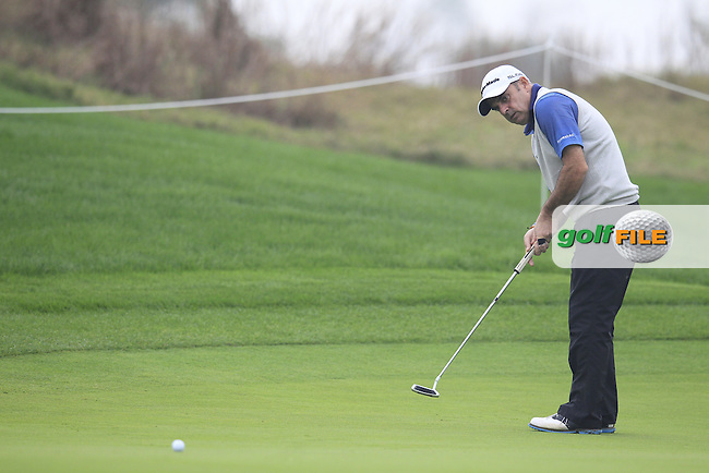 Paul McGinley (IRL) putts on the 5th green during Saturay's Round 3 of the 2014 BMW Masters held at Lake Malaren, Shanghai, China. 1st November 2014.<br /> Picture: Eoin Clarke www.golffile.ie