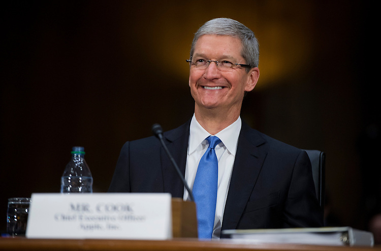 "UNITED STATES - MAY 21:  Tim Cook, CEO of Apple, testifies during a Senate Homeland Security and Governmental Affairs Subcommittee on Investigations in Dirksen Building titled ""Offshore Profit Shifting and the U.S. Tax Code - Part 2."" Cook and other Apple officials were on hand to explain the company's filings after the subcommittee accused Apple of tax avoidance. (Photo By Tom Williams/CQ Roll Call)"