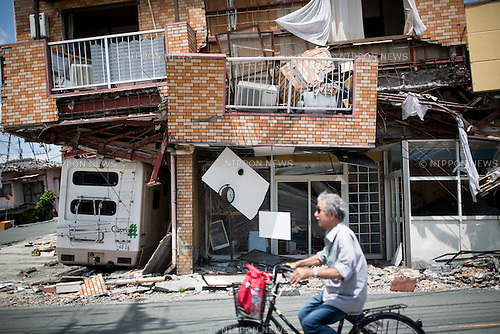 KUMAMOTO, JAPAN - APRIL 22: An earthquake survivor is seen through the wreckage of houses on April 22, 2016 in Mashiki town, Kumamoto, Japan. A series of earthquakes as big as magnitude 7.3 hit Kumamoto prefecture leaving 48 people dead and 263 seriously injured. Over 80,000 people were evacuated from their homes as a result. ( Photo by Richard Atrero de Guzman/AFLO)