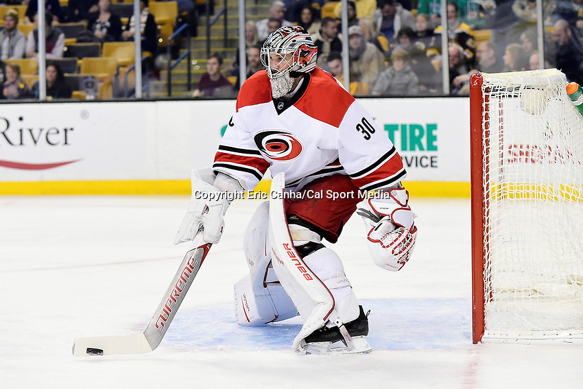 Thursday, December 1, 2016: Carolina Hurricanes goalie Cam Ward (30) paddles the puck away during the National Hockey League game between the Carolina Hurricanes and the Boston Bruins held at TD Garden, in Boston, Mass. Eric Canha/CSM