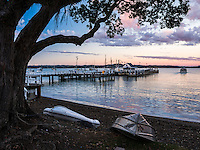 Boat and Russell Pier at sunset, Bay of Islands, Northland Region, North Island, New Zealand