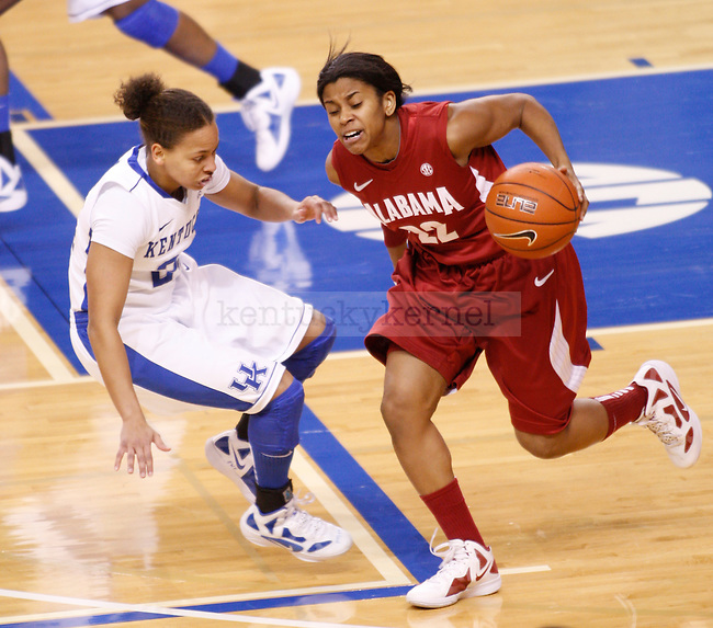 UK point guard Amber Smith guards Khristin Lee of Alabama during the first half of the UK Women's basketball game against Alabama on 1/29/12 at Memorial Coliseum in Lexington, Ky. Photo by Quianna Lige | Staff