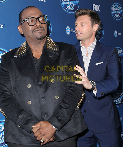 Randy Jackson & Ryan Seacrest.American Idol premiere event held at Royce Hall at UCLA in Westwood, California, USA..9th January 2013                                                                   .half length suit black glasses profile hands on shoulders gold studs studded spiked spikes goatee facial hair blue white shirt.CAP/DVS.©DVS/Capital Pictures.