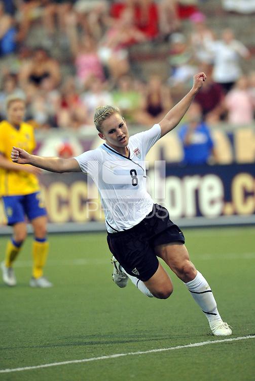 Amy Rodriguez celebrates opening goal...USWNT tied Sweden 1-1 at Morison Stadium, Nebraska.
