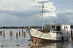 Boats anchored near shore in the Suriname River in the capital city of Paramaribo, Suriname.