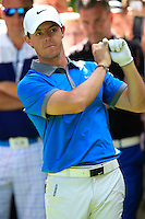 Rory McIlroy (NIR) prepares to play his 2nd shot from the trees after a wayward drive on the 18th hole during Friday's Round 2 of the 2014 Irish Open held at Fota Island Resort, Cork, Ireland. 20th June 2014.<br /> Picture: Eoin Clarke www.golffile.ie