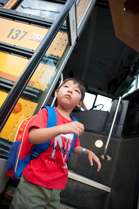 On June 17, 2012, Holden Miller, 5, boards his school bus for the first time as he heads off to a summer K-Ready program at Leopold Elementary in Madison, Wis.