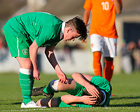 Aaron Connolly (At age 15) of Republic of Ireland U15 helps an injured teammate during the friendly with the Netherlands.<br /> <br /> Republic of Ireland v Netherlands, U15 International Friendly,14/4/15, Pearse Stadium, Janesboro FC, Limerick.