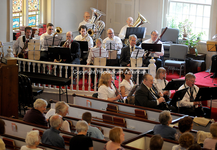 "NEW HARTFORD, CT-15 APRIL 2012--041512JS06-Members of the Farmington Valley Band, under the direction of Sam Hudak III, play ""Symphonic Dances from Fiddler on the Roof"" during a concert Sunday at the North Congregational Church in New Hartford. .Jim Shannon Republican-American"