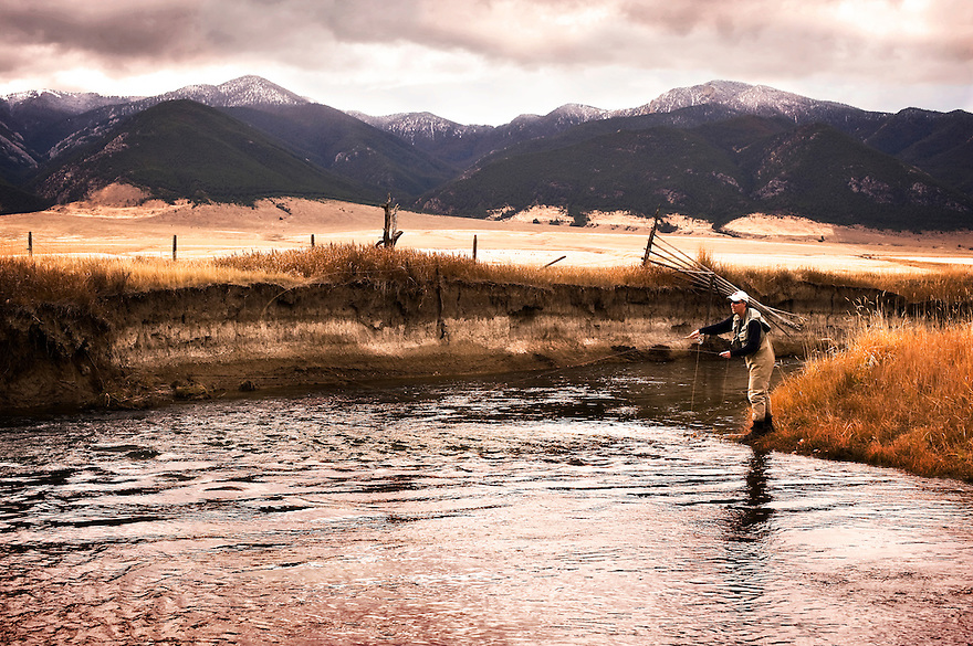 An angler fishes the Ruby River during the springtime near Alder, Montana.