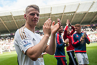 Stephen Kingsley on the pitch with team players and staff during a lap of honour after the Barclays Premier League match between Swansea City and Manchester City played at the Liberty Stadium, Swansea on the 15th of May  2016
