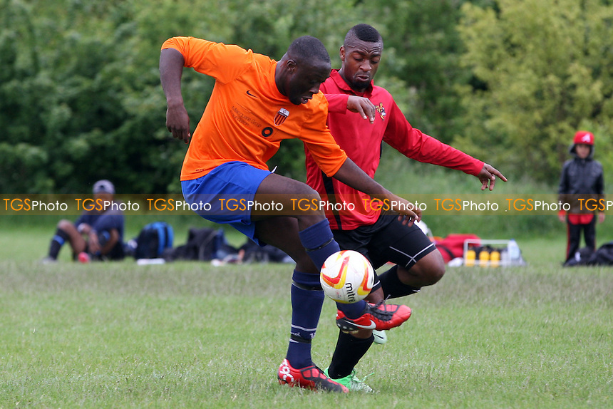 Reachout (Orange) vs Tottenham Phoenix (Red) - Hackney & Leyton Sunday League Football at South Marsh, Hackney Marshes, London - 09/06/13 - MANDATORY CREDIT: Dave Simpson/TGSPHOTO - Self billing applies where appropriate - 0845 094 6026 - contact@tgsphoto.co.uk - NO UNPAID USE
