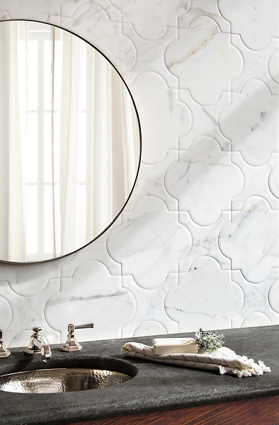 Mallorca Grand, a waterjet stone mosaic, shown in venetian honed Calacatta Tia, is part of the Miraflores Collection by Paul Schatz for New Ravenna.