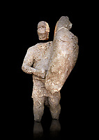 9th century BC Giants of Mont'e Prama  Nuragic stone statue of a boxer, Mont'e Prama archaeological site, Cabras. 2014 excavation. Civico Museo Archeologico Giovanni Marongiu - Cabras, Sardinia. Black background