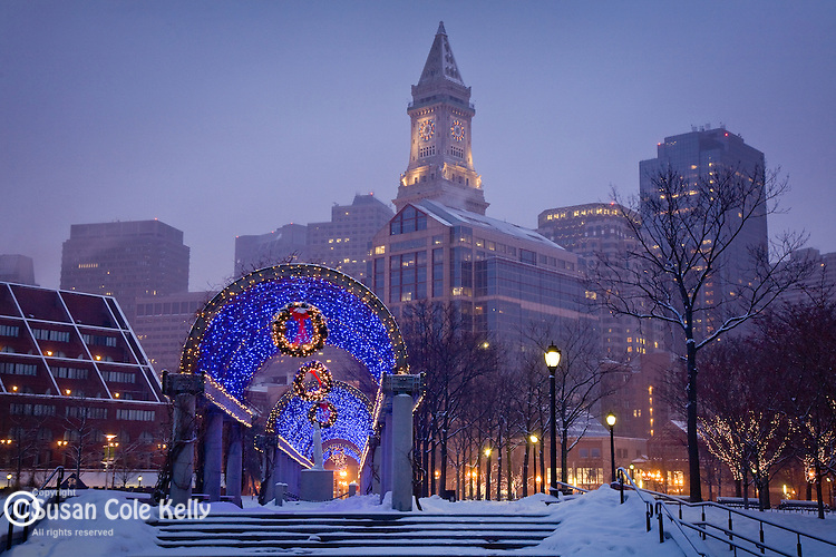 Snowy Christmas at Waterfront Park, showing the Financial District skyline in Boston, MA, USA