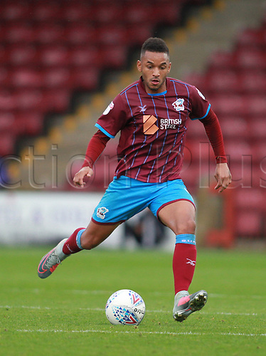 7th October 2017, Glanford Park, Scunthorpe, England; EFL League One football, Scunthorpe versus Wigan; Funso Ojo of Scunthorpe United about to pass the ball