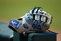 The Rawlings first baseman's glove of Cole Russo (33) of Tampa Jesuit HS in Tampa, FL sits on the dugout railing during the East Coast Pro Showcase at the Hoover Met Complex on August 5, 2020 in Hoover, AL. (Brian Westerholt/Four Seam Images)