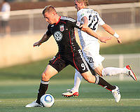 Danny Allsopp #9 of D.C. United is held by Jason Pelletier #22 of the Harrisburg City Islanders during a US Open Cup match at the Maryland Soccerplex on July 21 2010, in Boyds, Maryland. United won 2-0.