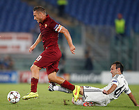 Calcio, Champions League, Gruppo E: Roma vs CSKA Mosca. Roma, stadio Olimpico, 17 settembre 2014.<br /> Roma forward Francesco Totti is tackled by CSKA Moskva midfielder Bebras Natcho, of Israel, right, during the Group E Champions League football match between AS Roma and CSKA Moskva at Rome's Olympic stadium, 17 September 2014.<br /> UPDATE IMAGES PRESS/Riccardo De Luca