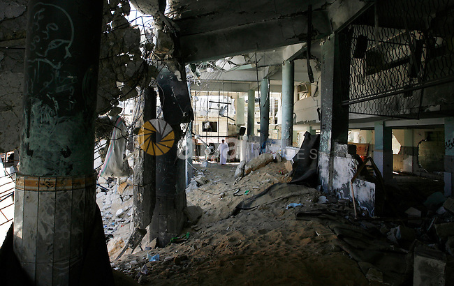 A Palestinian man walks at the heavily damaged al-Faruq mosque which was destroyed by Israeli strikes during the summer's fierce offensive, in Rafah in the southern Gaza Strip September 21, 2014. Photo by Abed Rahim Khatib