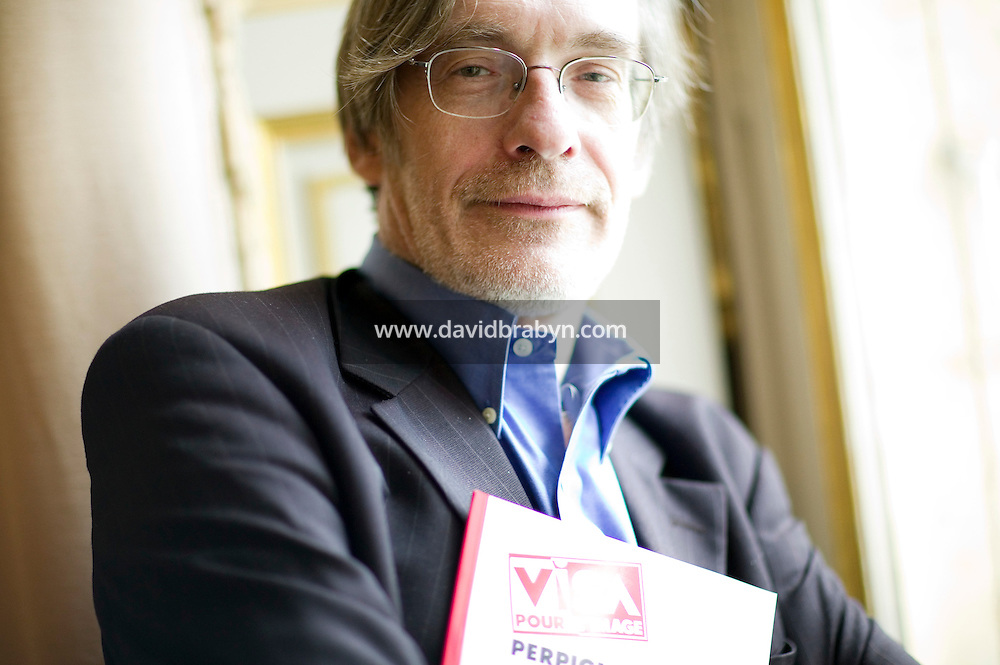 "Jean-Francois Leroy, general manager of ""Visa pour l'image"", an annual photojournalism festival held every September in Perpignan, poses for the photographer after giving a press conference in Paris, France, to present the 19th edition of the event, 15 May 2007."