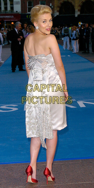 "SCARLETT JOHANSSON.""The Island"" UK Film Premiere, Odeon Leicester Square, WC2.August 7th, 2005.full length silver silk satin strapless dress red shoes looking over shoulder bow ribbon.www.capitalpictures.com.sales@capitalpictures.com.©Capital Pictures"