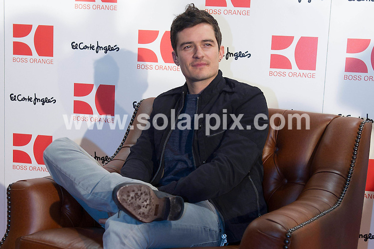 **ALL ROUND PICTURES FROM SOLARPIX.COM**                                             **WORLDWIDE SYNDICATION RIGHTS EXCEPT SPAIN AND PORTUGAL -  NO SYNDICATION IN SPAIN & PORTUGAL**                                                                                  Caption:  Orlando Bloom is all smiles as he attends a photo call to launch the new Boss Orange men's fragrance at El Corte Ingles on Wednesday (March 16) in Madrid, Spain..The 34-year-old English actor has been the face of Boss Orange since July of last year.                                                                             This pic: Orlando Bloom                                                                                             JOB REF:12980        DYD       DATE: 16.03.2011                                                           **MUST CREDIT SOLARPIX.COM OR DOUBLE FEE WILL BE CHARGED**                                                                      **MUST AGREE FEE BEFORE ONLINE USAGE**                               **CALL US ON: +34 952 811 768 or LOW RATE FROM UK 0844 617 7637**