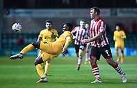 Northampton Town's Ash Taylor clears under pressure from Lincoln City's Matt Rhead<br /> <br /> Photographer Andrew Vaughan/CameraSport<br /> <br /> Emirates FA Cup First Round - Lincoln City v Northampton Town - Saturday 10th November 2018 - Sincil Bank - Lincoln<br />  <br /> World Copyright © 2018 CameraSport. All rights reserved. 43 Linden Ave. Countesthorpe. Leicester. England. LE8 5PG - Tel: +44 (0) 116 277 4147 - admin@camerasport.com - www.camerasport.com