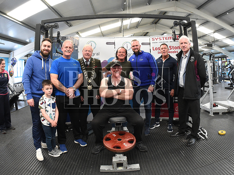 Liam O'Keefe who performed 3019 reps in less than an hour in Integral Gym to raise funds for Hannah The Princess Warrior pictured with Mayor of Drogheda Frank Godfrey and gym staff. Photo:Colin Bell/pressphotos.ie