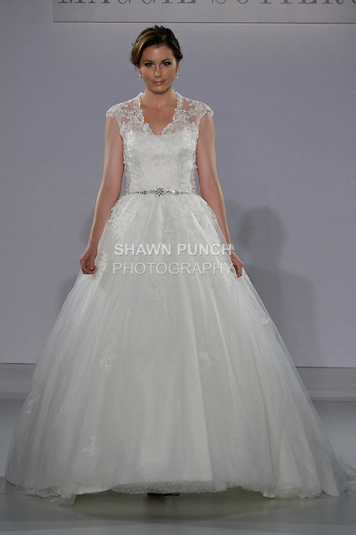 Model walks runway in a Windsor wedding gown from the Maggie Sottero Spring 2013 collection, at The Couture Show, during New York Bridal Fashion Week, on October 14, 2012.