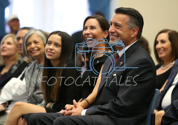 Gov. Brian Sandoval unveils his official portrait during a ceremony at the Capitol in Carson City, Nev., on Thursday, Oct. 25, 2018. His daughter Marisa, 14, and his wife Lauralyn were among the family and friends on hand for the ceremony. <br /> Photo by Cathleen Allison/Nevada Momentum