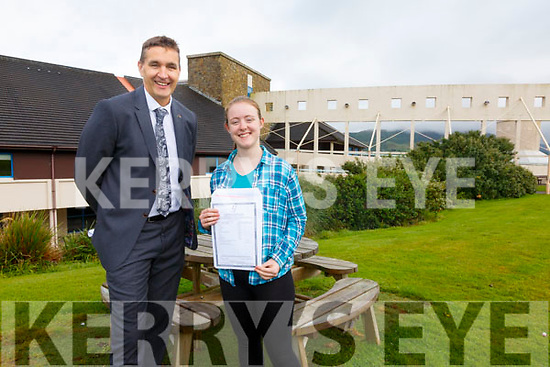 Colaiste na Sceilge student Tara Whittington pictured here with Maurice Fitzgerald (Principal) who scooped 620 points in her Leaving Cert with 6 H1's and 1 H2.