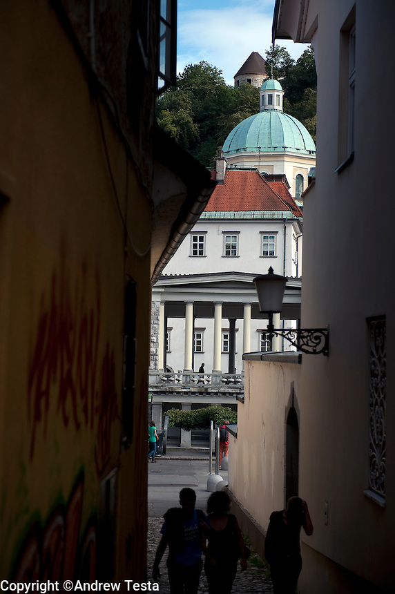 SLOVENIA. Ljubljana . 26th July 2011.<br /> St Nicholas Cathedral viewed through a side street in Ljubljana.<br /> &copy;Andrew Testa for the New York Times