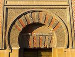 Moorish doorway arch elaborately inscribed stonework of the mezquita Great Mosque, Cordoba, Spain