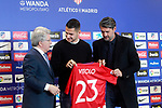 Atletico de Madrid's new player Victor Machin Vitolo (c) with the President Enrique Cerezo (l) and the General Manager Jose Luis Perez Caminero during his official presentation. December 31, 2016. (ALTERPHOTOS/Acero)