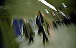 Commuters in the corridor of a train station. London