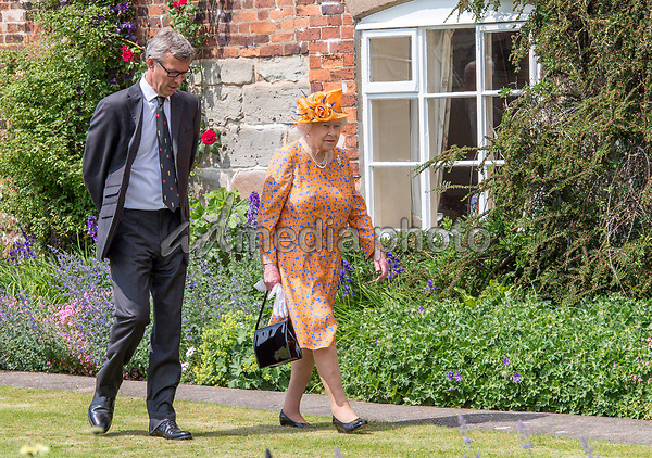 25 May 2017 - Queen Elizabeth II with Nathan Thompson, the Cheif Executive of the Douchy of Lancaster estate at Lower Castle Hayes farm, during a visit to one of the Duchy of Lancaster Farms in Staffordshire. Photo Credit: ALPR/AdMedia