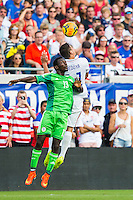 June 07, 2014:   the United States of America midfielder Alejandro Bedoya (11) heads a ball while being defended by Nigeria defender Juwon Oshaniwa (13) during action between the USA Men's National Soccer team and Nigeria at EverBank Field in Jacksonville, Florida.  This is the last match before the USA team leaves for Brazil and the 2014 World Cup Championships.  The USA Team defeated Nigeria 2-1.